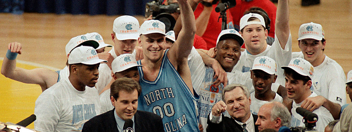 Dean Smith (lower right, pointing) celebrates his second National Championship in 1993
