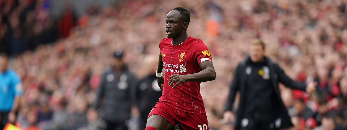 Liverpool's Sadio Mane controls the ball during the English Premier League soccer match between Liverpool and Bournemouth at Anfield stadium in Liverpool, England, Saturday, March 7, 2020.