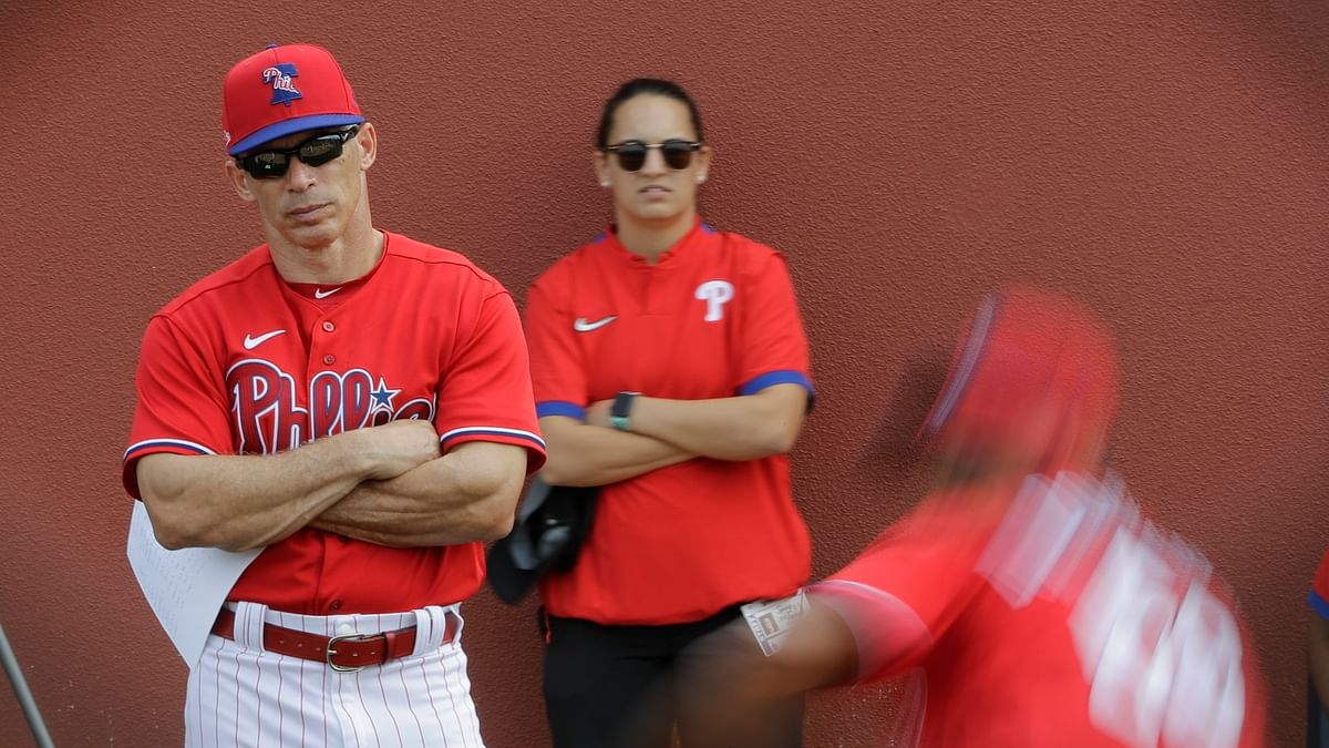 Philadelphia Phillies manager Joe Girardi watches pitchers in the bullpen during a spring training baseball workout Friday, Feb. 14, 2020, in Clearwater, Florida.
