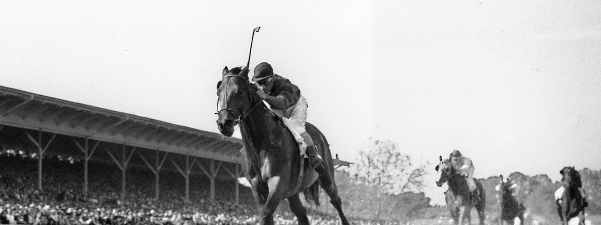 In this June 12, 1948, file photo, Citation, jockey Eddie Arcado up, races for a win and the Triple Crown in the $100,000 added Belmont Stakes at Belmont Park race track in Elmont, N.Y. Secretariat is the early 7-2 favorite for this weekend's virtual Kentucky Derby, an animated race pitting all 13 Triple Crown winners on the day the Derby would have been held before the coronavirus pandemic postponed it. Citation was made the 4-1 second choice.