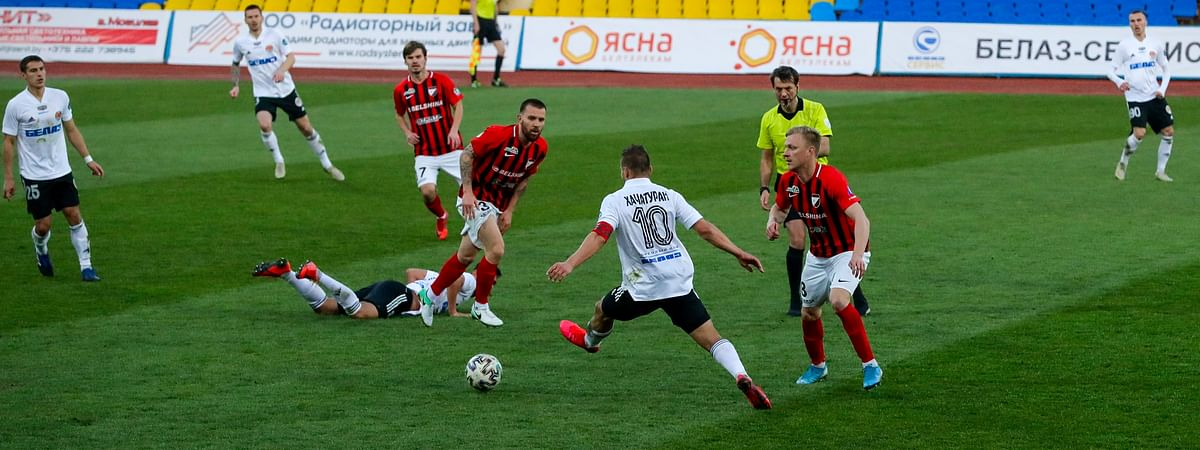 In this file photo taken on Friday, March 27, 2020, players in action during the Belarus Championship soccer match between Torpedo-BelAZ Zhodino and Belshina Bobruisk in the town of Zhodino, Belarus.