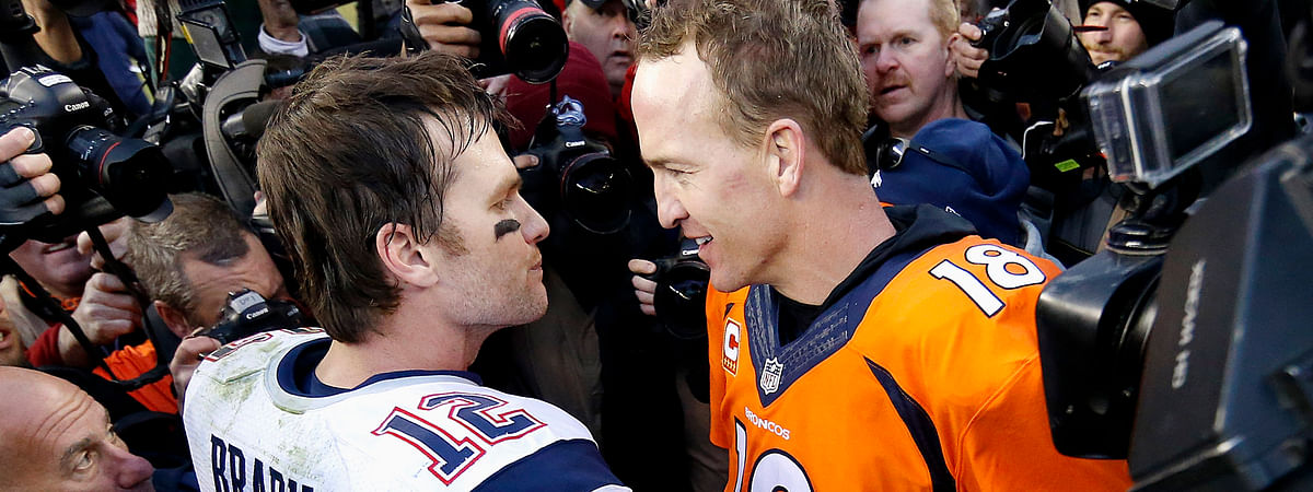 In this Jan. 24, 2016, file photo, New England Patriots quarterback Tom Brady, left, and Denver Broncos quarterback Peyton Manning speak to one another about maybe playing in a charity golf tournament during a pandemic in a few years.