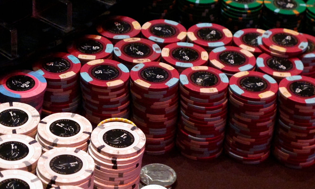 This Feb. 22, 2019 photo shows stacks of gambling chips at the Golden Nugget casino in Atlantic City N.J. As of Monday, March 16, 2020, casinos in at least 15 states had shut down due to the coronavirus, including Atlantic City's nine casinos which were due to close at 8 p.m.