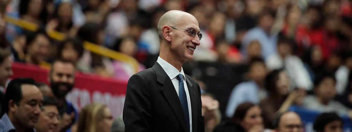In this Oct. 8, 2019 file photo, NBA Commissioner Adam Silver is introduced during an NBA preseason basketball game between the Houston Rockets and the Toronto Raptors in Saitama, near Tokyo. Silver said in an interview Saturday, March 21, 2020 that the league is considering all options, best-case, worst-case and countless ideas in between, as it tries to come to grips with the coronavirus pandemic.
