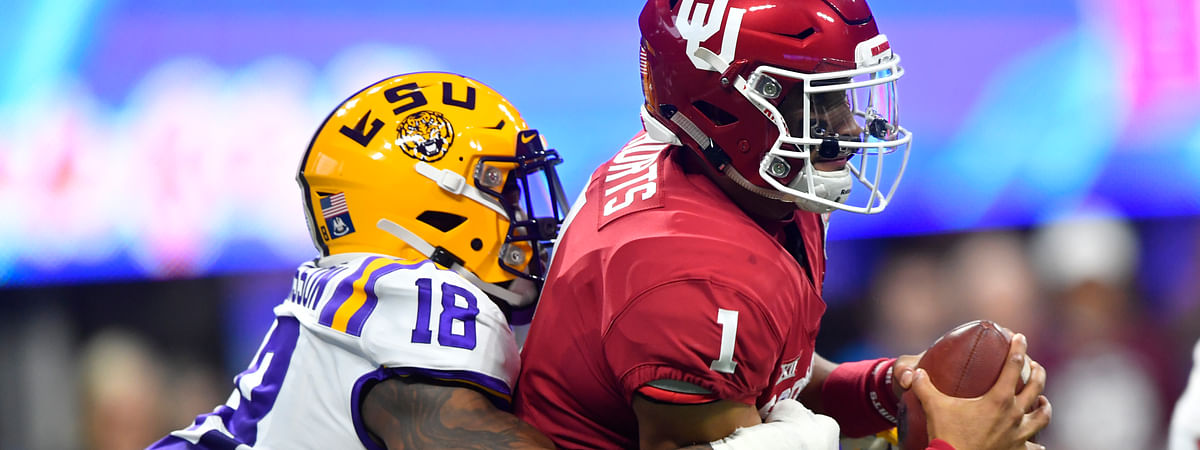 In this Dec. 28, 2019, file photo, LSU linebacker K'Lavon Chaisson (18) sacks Oklahoma quarterback Jalen Hurts (1) during the first half of the Peach Bowl NCAA semifinal college football playoff game in Atlanta. Chaisson was chosen by the Jacksonville Jaguars in the first round of the NFL draft on April 23, 2020. Hurts was selected by the Philadelphia Eagles in the second round of the NFL football draft on April 24, 2020.