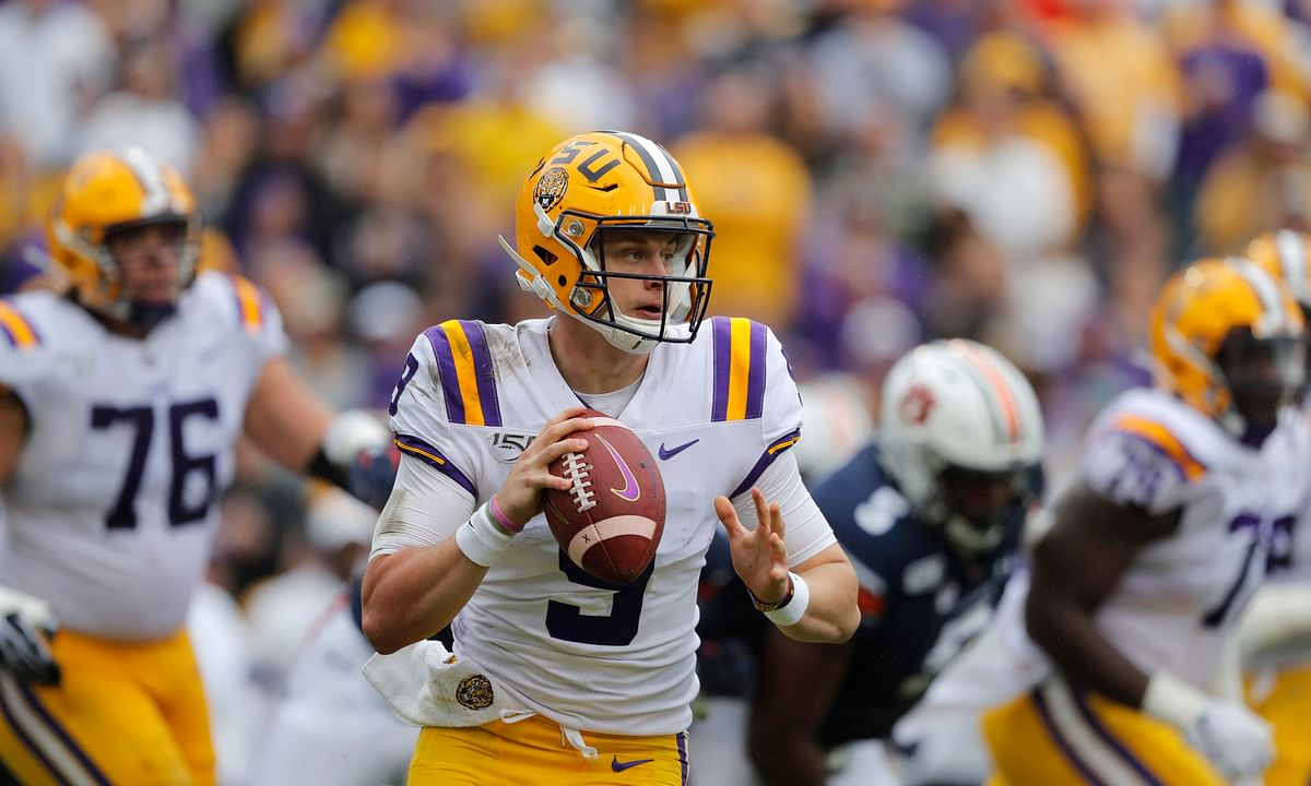 In this Oct. 26, 2019, file photo, LSU quarterback Joe Burrow (9) scrambles during the first half of the team's NCAA college football game against Auburn in Baton Rouge, La. Burrow is the top quarterback heading in the upcoming NFL draft.