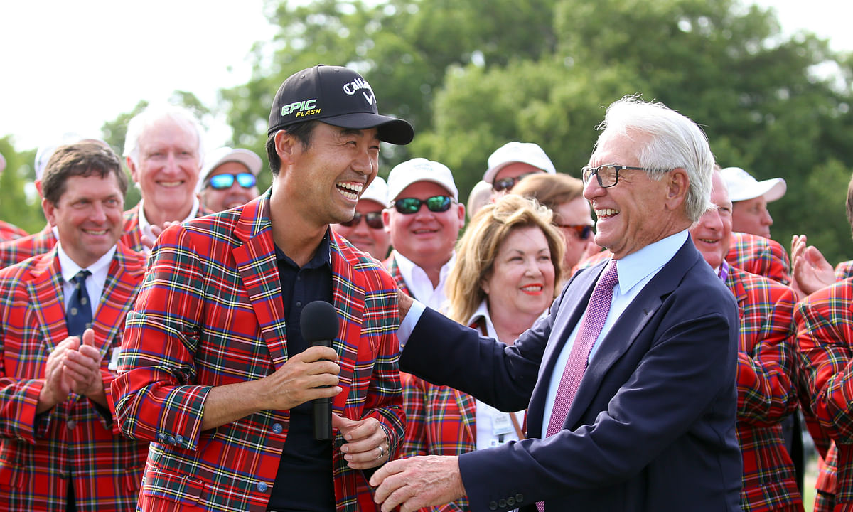 FILE - In this May 26, 2019, file photo, Kevin Na, front left, is congratulated by Charles Schwab after winning The Charles Schwab Challenge at Colonial in Fort Worth, Texas. The PGA Tour laid out an ambitious plan to resume its season Thursday, April 16, 2020, with hopes of a restart at Colonial on June 11-14 and keeping fans away for at least the first month. (AP Photo/ Richard W. Rodriguez, File)