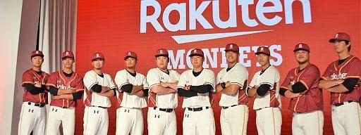 The Rakuten Monkeys strike a pose.
