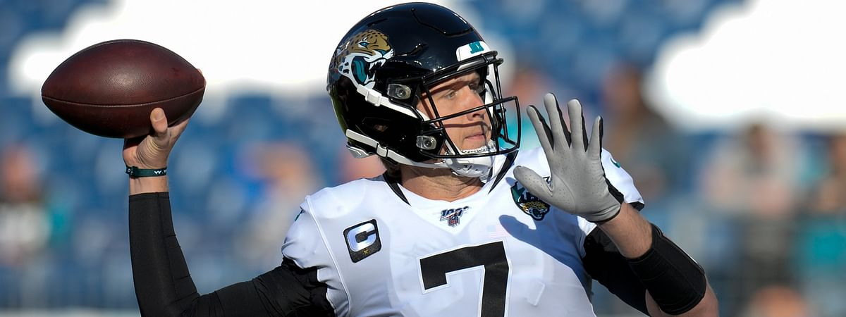 In this Nov. 24, 2019, file photo, Jacksonville Jaguars quarterback Nick Foles warms up before an NFL football game against the Tennessee Titans in Nashville, Tenn. Chicago sent a 2020 compensatory fourth-round draft pick to Jacksonville in the trade.