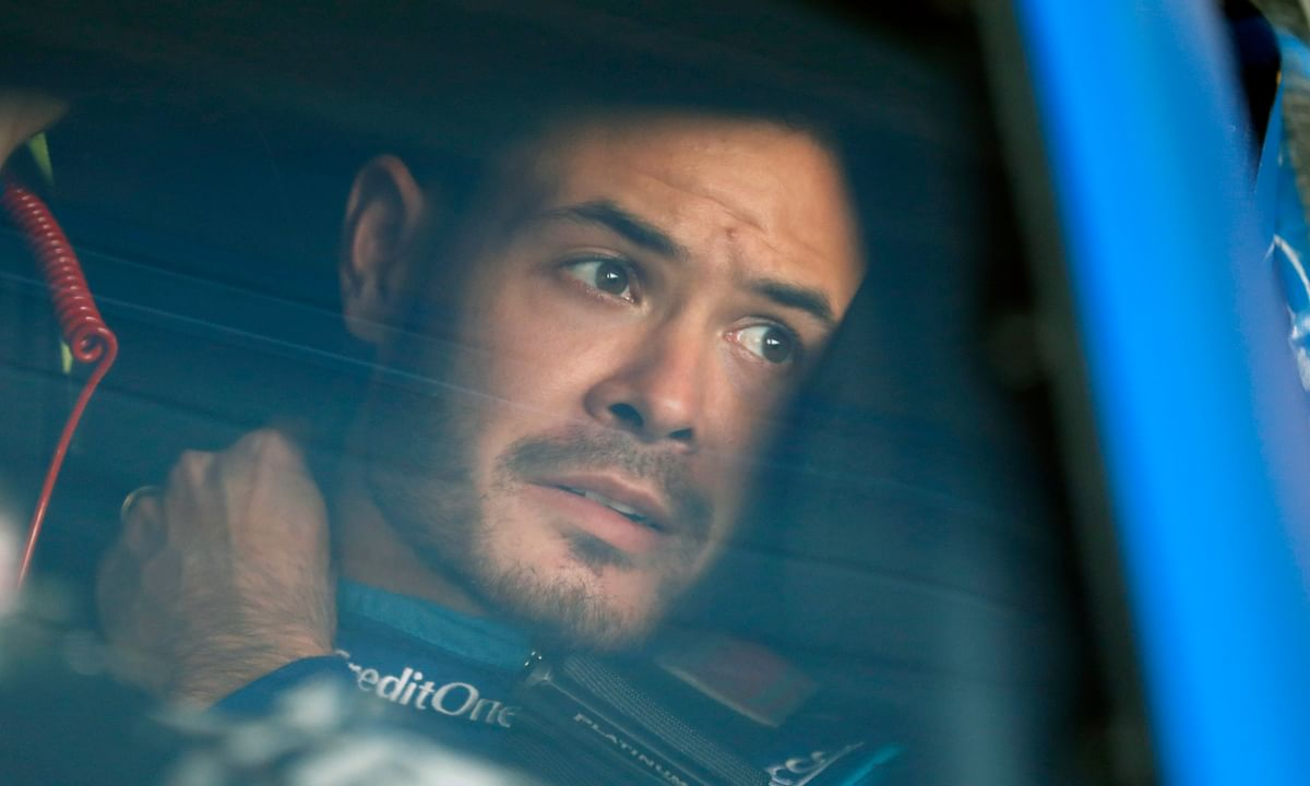 In this Oct. 18, 2019, file photo, Kyle Larson sits in his car before the final practice for a NASCAR Cup Series auto race at Kansas Speedway in Kansas City, Kan. Larson, in his seventh Cup season with Ganassi and considered the top free agent in NASCAR mere weeks ago, is now stunningly out of a job in what could ultimately be an eight-figure blunder by the star.