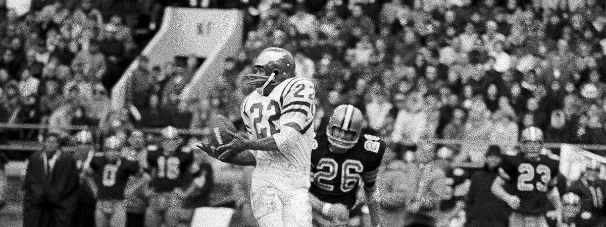 Timmy Brown catches a pass from Norm Snead in a game against the Saints at Franklin Field on Nov. 20, 1967