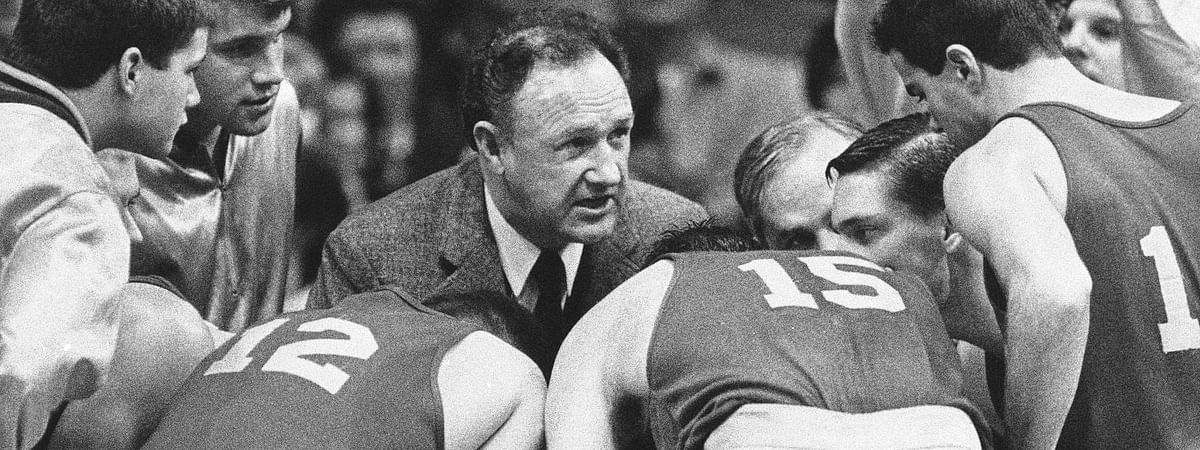 """In this Dec, 6, 1985, file photo, actor Gene Hackman gives fictional Hickory High basketball players instructions during filming of the final game of the movie """"Hoosiers"""" at Hinkle Fieldhouse on the Butler University campus in Indianapolis. """"Hoosiers"""" shot all the way to No. 1 in The Associated Press Top 25 of best sports movies, a one-of-a-kind poll from the news organization known for its rankings of college teams."""