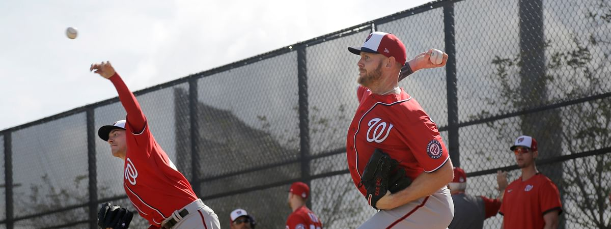 Washington Nationals pitchers Patrick Corbin, left, and Stephen Strasburg throw bullpen sessions during spring training baseball practice Friday, Feb. 14, 2020, in West Palm Beach, Fla. (AP Photo/Jeff Roberson)