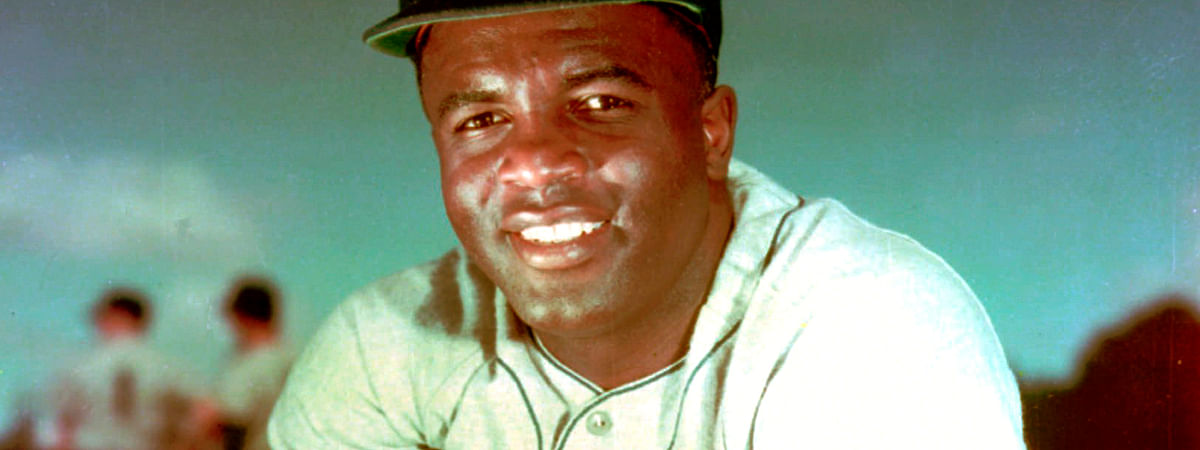 In this 1952 file photo, Brooklyn Dodgers baseball player Jackie Robinson poses. Forced from the field by the new coronavirus, Major League Baseball is moving its annual celebration of Jackie Robinson online. The Jackie Robinson Foundation is launching a virtual learning hub to coincide with the 73rd anniversary Wednesday, April 15, 2020, of Robinson breaking the major league color barrier.