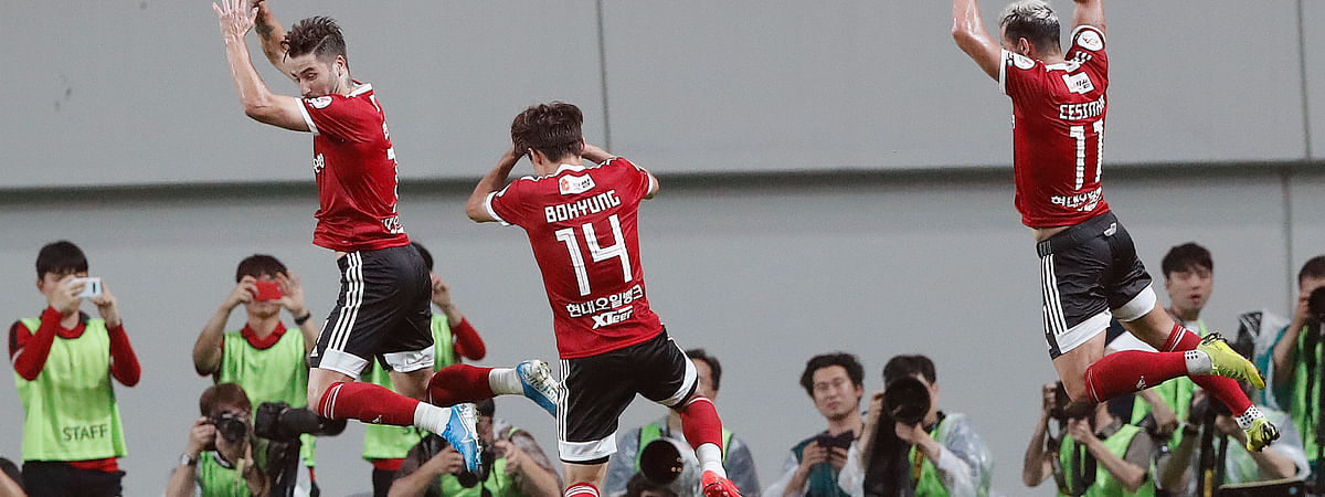 In this July 26, 2019, file photo, Cesinha, right, of Team K League jumps with his teammates to celebrate after scoring a goal against Juventus during a friendly match at the Seoul World Cup Stadium in Seoul, South Korea. Players, coaches and fans have two weeks to get used to new rules around soccer in South Korea after the K-League announced that the delayed season will kick off on May 8.