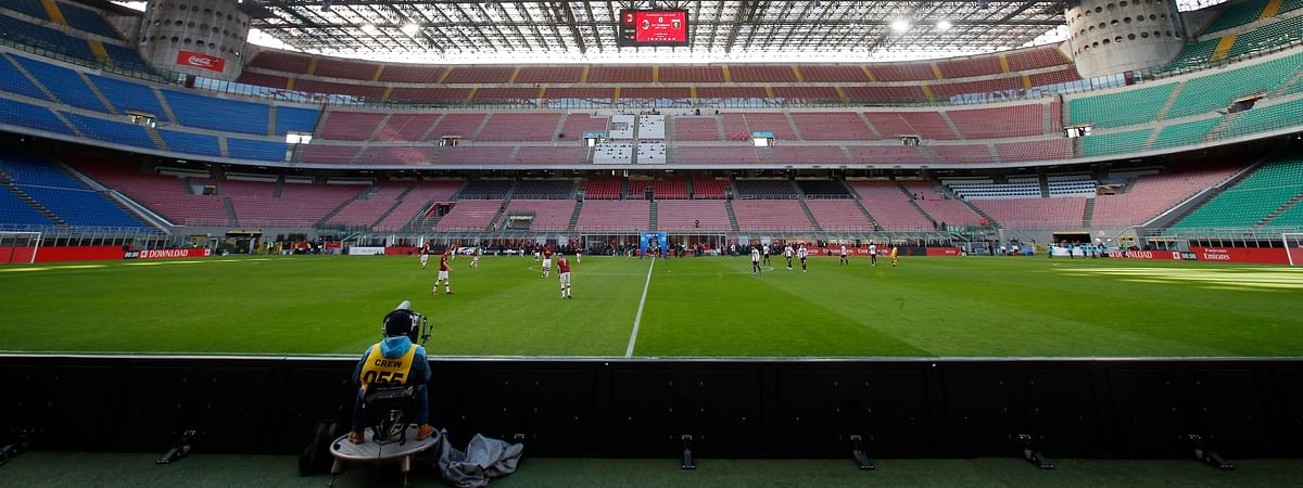 In this Sunday, March 8, 2020 filer, a view of the empty stadium during the Serie A soccer match between AC Milan and Genoa at the San Siro stadium, in Milan, Italy. While soccer leagues around Europe are still debating whether and when to resume playing, the leader of the continent's Federation of Sports Medicine Associations is calling for a detailed series of tests to clear athletes for a return to training.