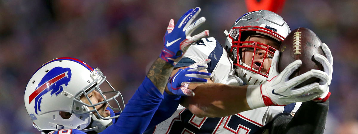 In this Oct. 29, 2018, file photo, New England Patriots tight end Rob Gronkowski, right, makes a catch next to Buffalo Bills defensive back Phillip Gaines during the second half of an NFL football game in Orchard Park, N.Y.