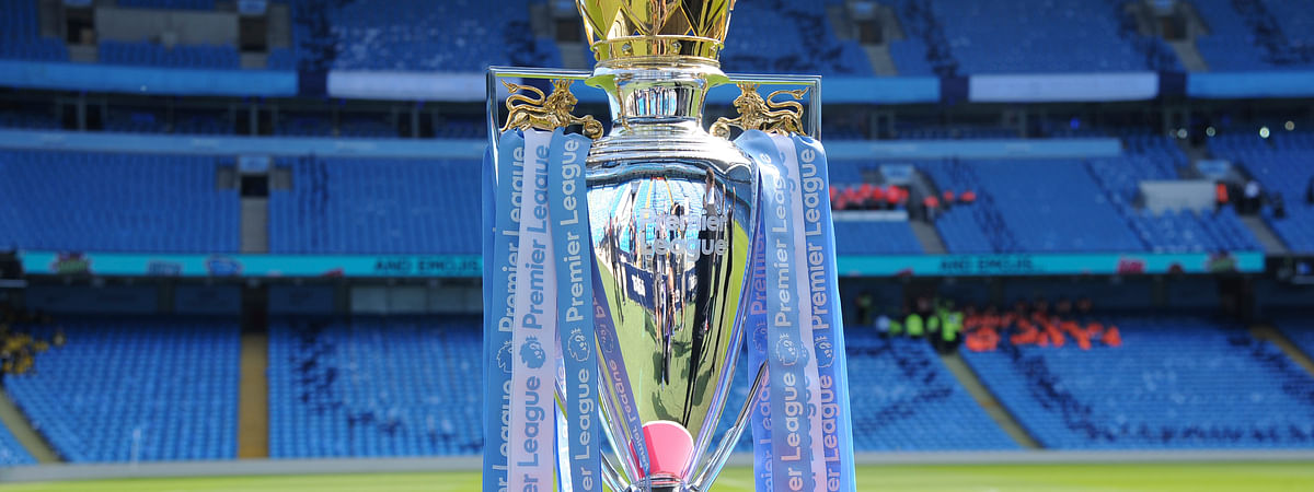 In this Sunday, May 6, 2018 file photo, the English Premier League trophy is displayed on the pitch prior to the English Premier League soccer match between Manchester City and Huddersfield Town at Etihad stadium in Manchester, England.