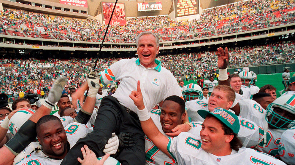 Miami Dolphins coach Don Shula is carried on his team's shoulders after his record 325th victory, against the Eagles in Philadelphia on Nov. 14, 1993
