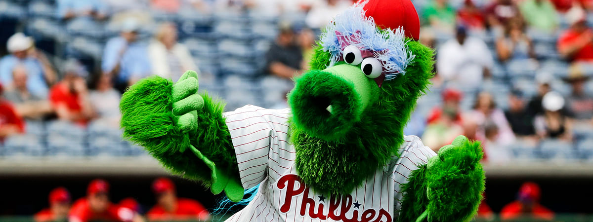 In this Feb. 25, 2020, file photo, The Phillie Phanatic mascot performs before a spring training baseball game against the Toronto Blue Jays in Clearwater, Fla. Mascots have no other place in baseball should the sport resume. Mascots will be banned.