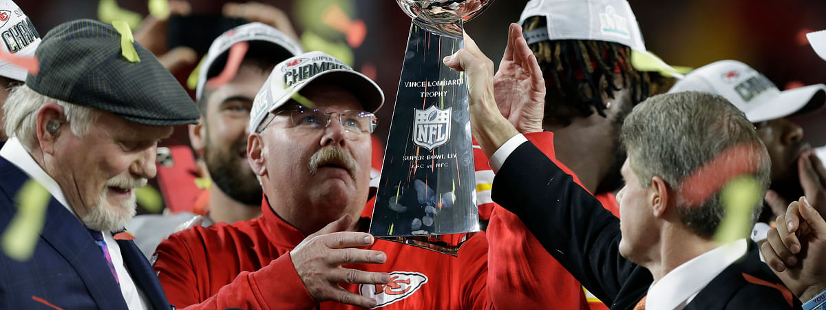 In this Feb. 2, 2020, file photo, Kansas City Chiefs chairman Clark Hunt, right, hands the trophy to head coach Andy Reid after the chiefs defeated the San Francisco 49ers in the NFL Super Bowl 54 football game in Miami Gardens, Florida.