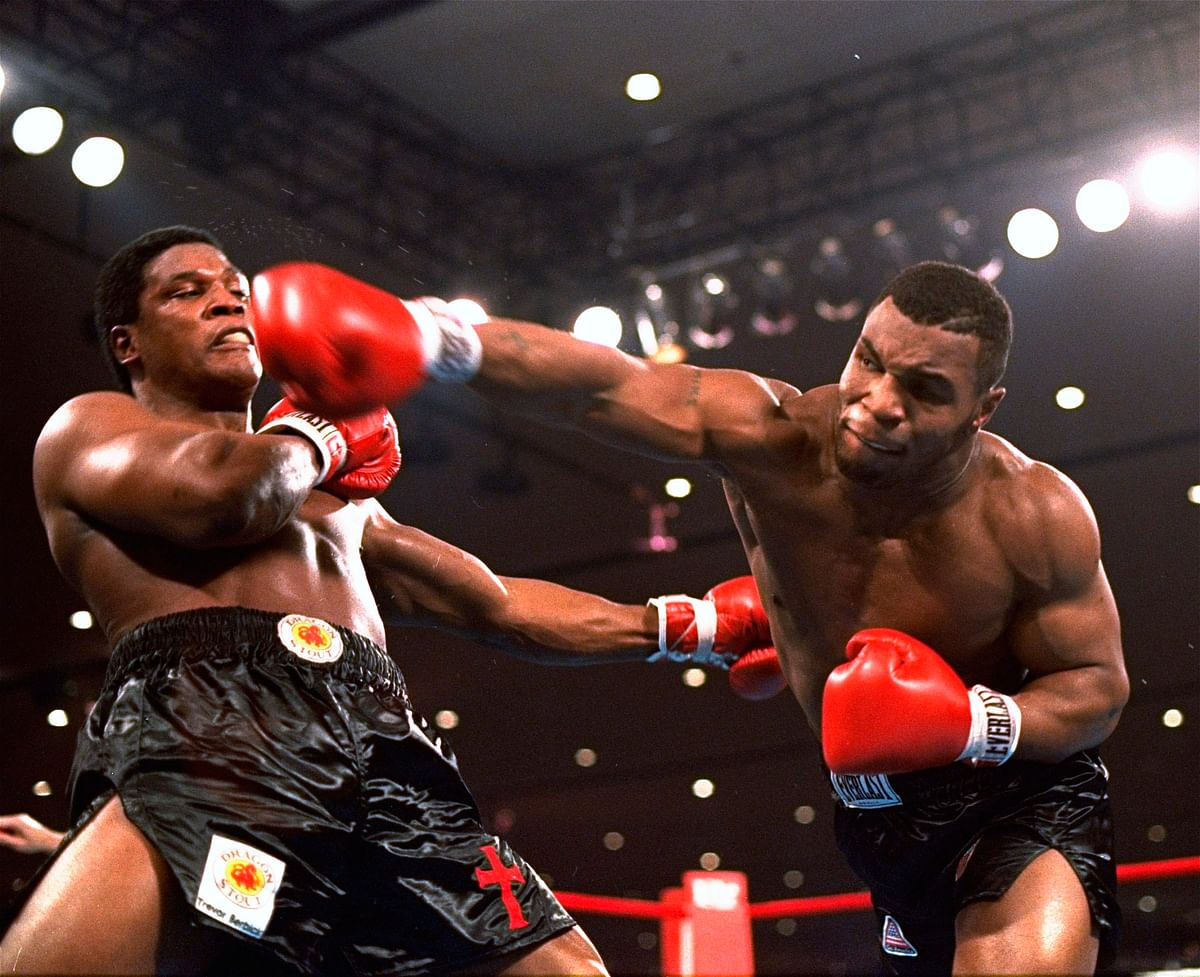 In this Nov. 22, 1986, file photo, Mike Tyson, right, delivers a blow to Trevor Berbick during a boxing bout in Las Vegas.