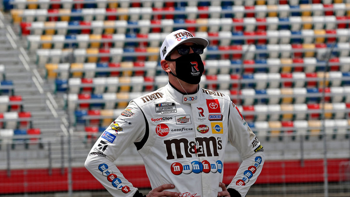Driver Kyle Busch watches during qualifying for the NASCAR Cup Series auto race at Charlotte Motor Speedway Sunday, May 24, 2020, in Concord, N.C.