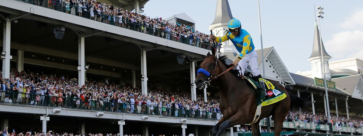 In this May 2, 2015, file photo, Victor Espinoza rides American Pharoah to victory in the 141st running of the Kentucky Derby horse race at Churchill Downs in Louisville, Ky. American Pharaoh went on to win the Triple Crown a few weeks later. More than a dozen thoroughbreds had come up a race short of becoming racing's first Triple Crown winner since Affirmed in 1978, until American Pharoah ended the 37-year drought in 2015.