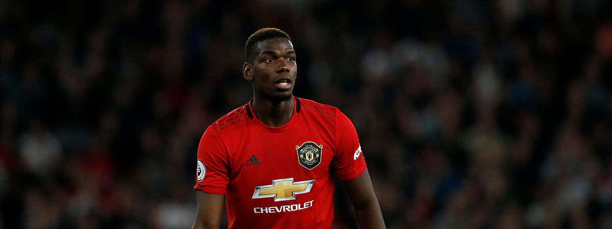 In this Monday, Aug. 19, 2019 file photo, Manchester United's Paul Pogba reacts during their English Premier League soccer match against Wolverhampton Wanderers at the Molineux Stadium in Wolverhampton, England. Paul Pogba and Marcus Rashford are expected to be available for Manchester United whenever the Premier League is allowed to resume after its suspension because of the coronavirus outbreak. They were both sidelined with long-term injuries at the time play was halted in England.