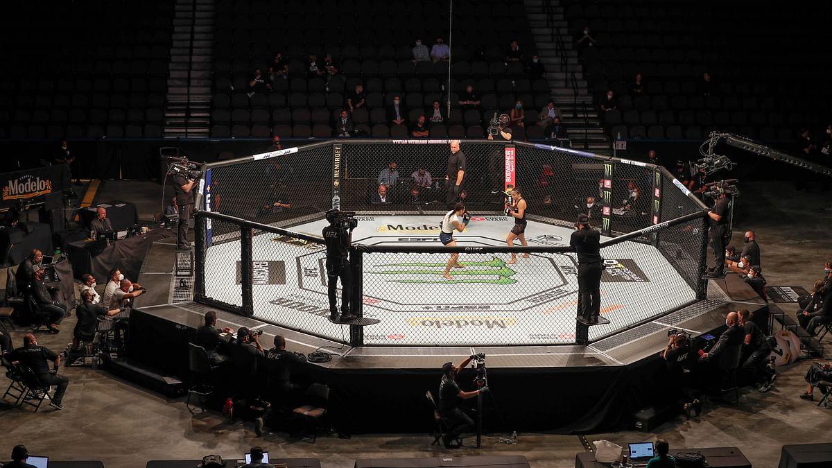 Gaethje stuns Ferguson; Cejudo, Ngannou, Hardy, Esparza win as UFC 249 ushers in fan-free, mask-filled era of sports