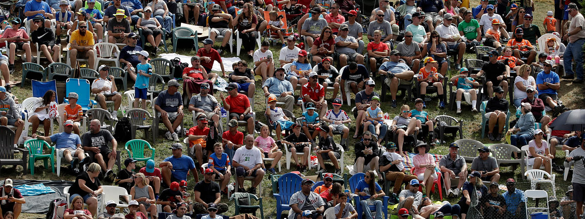 Little League World Series fans watch from the hillside overlooking left field at Lamade Stadium during the 2019 International Championship Game between Curacao and Japan