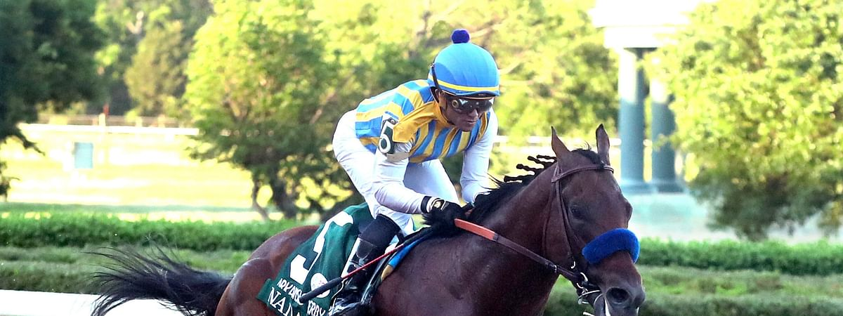 Joel Rosario, top, and Nadal cross the wire to win the second division of the Arkansas Derby horse race Saturday, May 2, 2020, at Oaklawn Racing Casino Resort in Hot Springs, Ark.