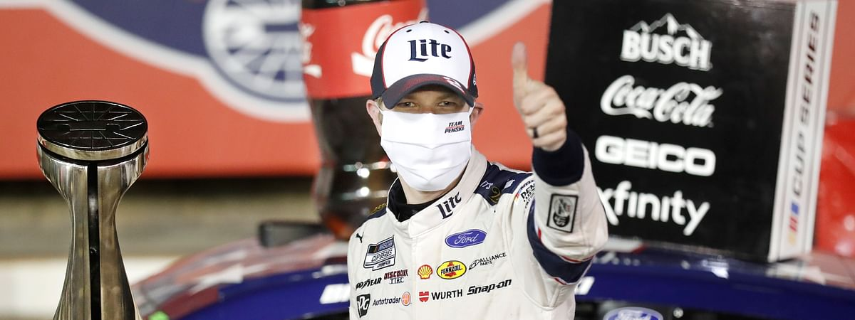 Brad Keselowski celebrates after winning the NASCAR Cup Series auto race at Charlotte Motor Speedway early Monday, May 25, 2020, in Concord, N.C.