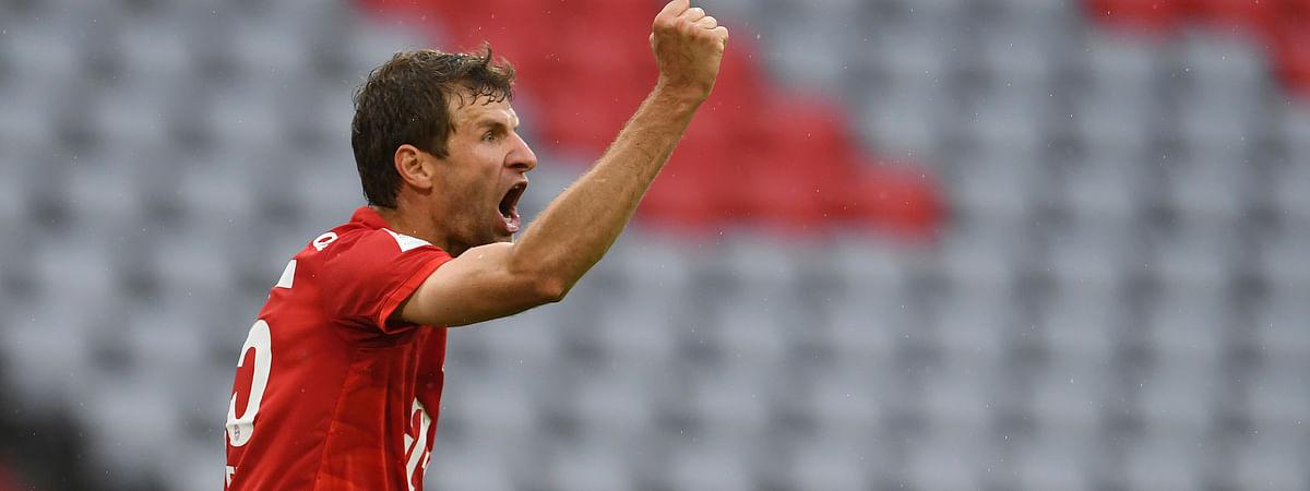 Bayern Munich's Thomas Muller celebrates scoring his side's second goal the German Bundesliga soccer match between Bayern Munich and Eintracht Frankfurt in Munich, Germany, Saturday, May 23, 2020.