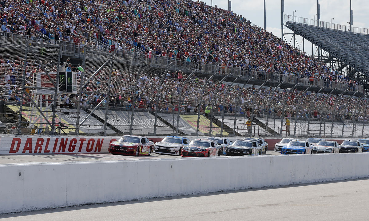 FILE - In this Aug. 31, 2019, file photo, Ryan Blaney leads the field to the start the NASCAR Xfinity Series auto race at Darlington Raceway in Darlington, S.C. NASCAR will resume its season without fans May 17 at Darlington. (AP Photo/Terry Renna, File)
