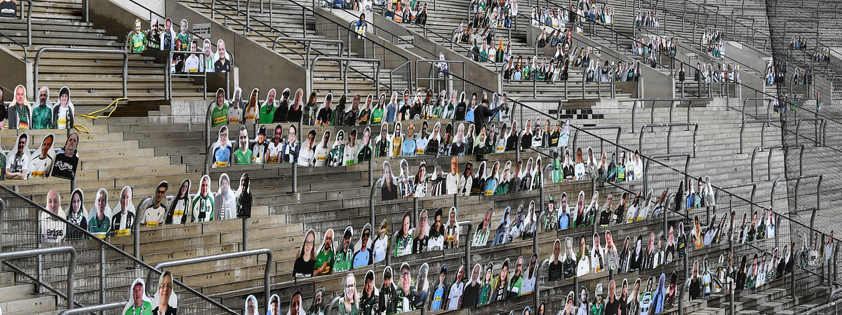 In this Thursday, April 16, 2020 file photo, portraits of fans of German Bundesliga soccer club Borussia Moenchengladbach are set on the supporters tribune in the stadium in Moenchengladbach, Germany.