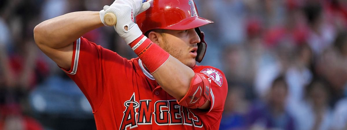 In this July 25, 2019, file photo, Los Angeles Angels' Mike Trout bats during the first inning of the team's baseball game against the Baltimore Orioles in Anaheim, California.