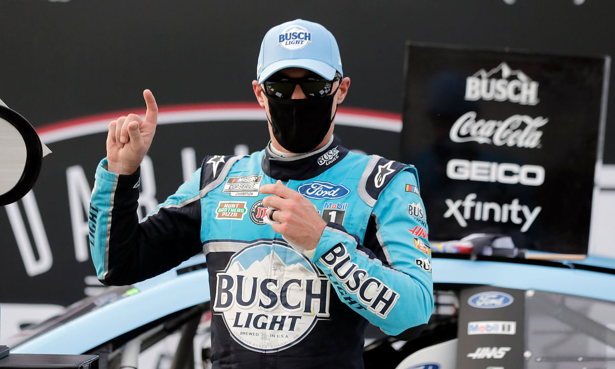 Kevin Harvick celebrates after winning the NASCAR Cup Series auto race Sunday, May 17, 2020, in Darlington, S.C.