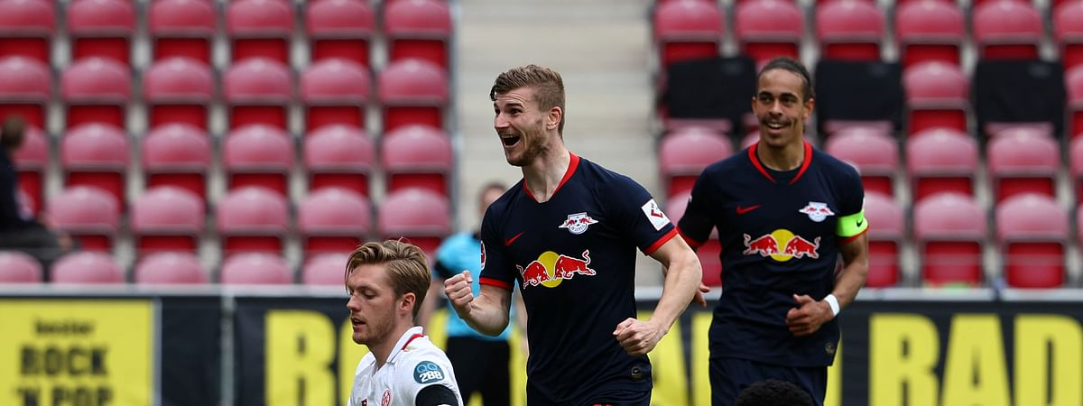 Leipzig's Timo Werner celebrates scoring their fourth goal during a German Bundesliga soccer match between FSV Mainz 05 and RB Leipzig in Mainz, Germany, Sunday, May 24, 2020.