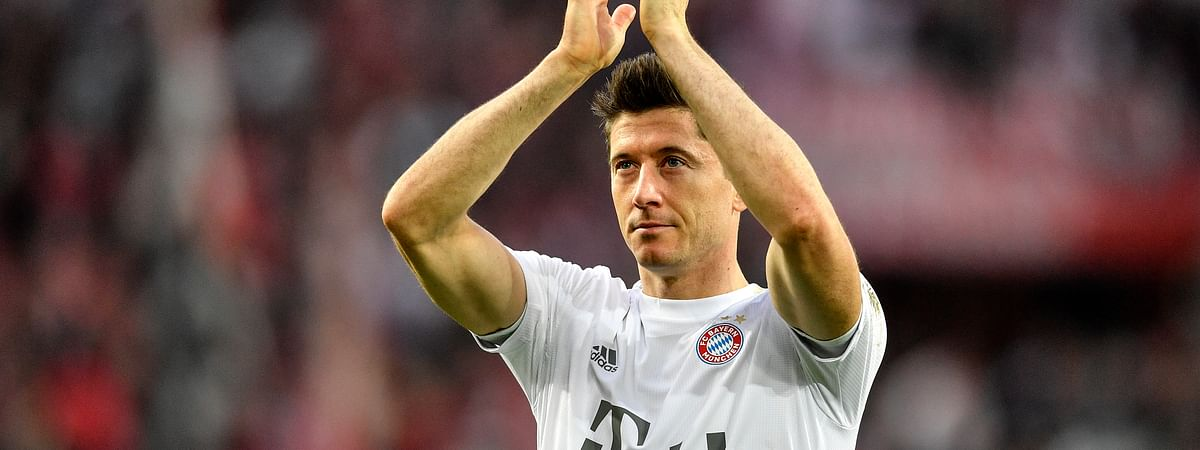 In this Sunday, Feb. 16, 2020 file photo, Bayern's Robert Lewandowski celebrates with supporters after winning their German Bundesliga soccer match against 1. FC Cologne in Cologne, Germany. Bayern's Robert Lewandowski, Borussia Dortmund's Erling Haaland and Leipzig's Timo Werner have all been crucial to their team's challenges with explosive scoring form.