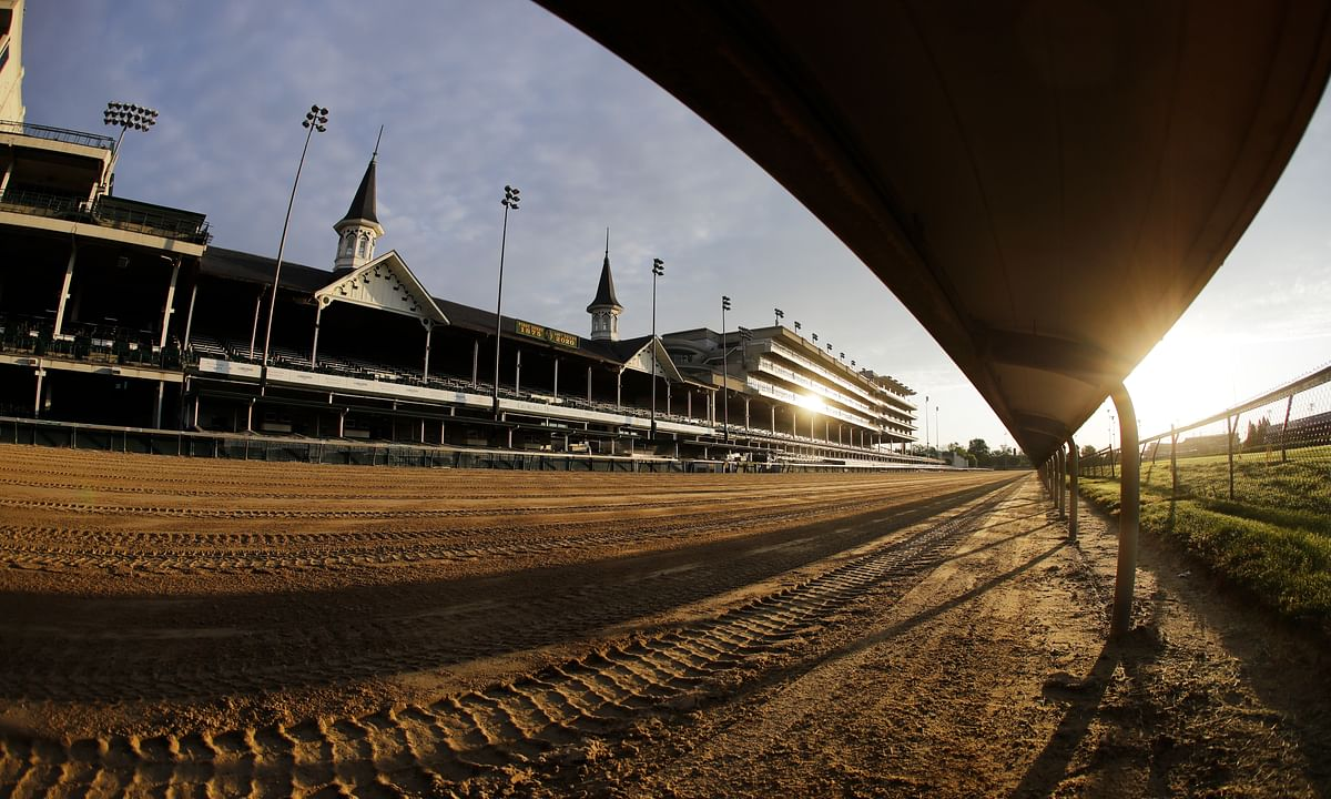 The sun rises over the track at Churchill Downs, Thursday, May 7, 2020, in Louisville, Ky.