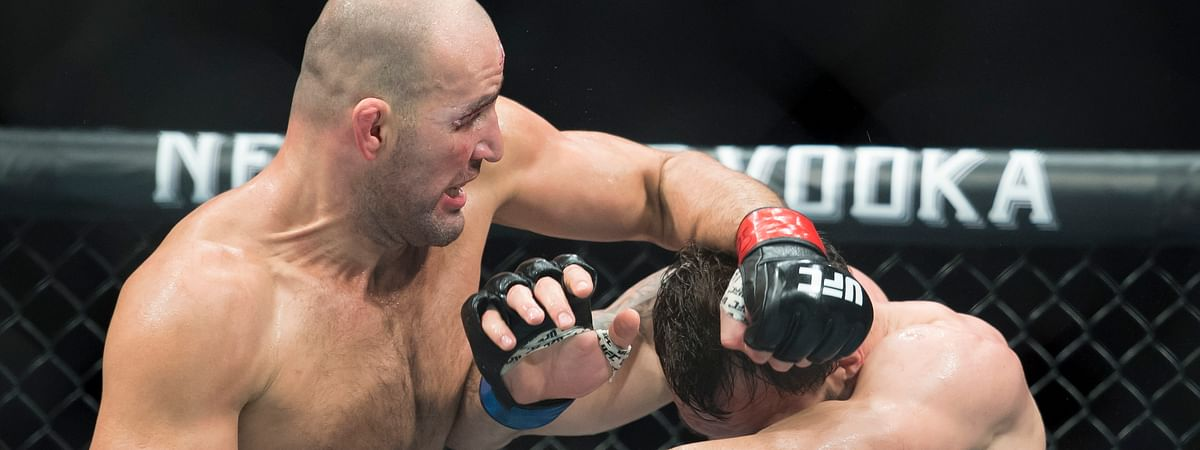 In this Sept. 14, 2019, file photo, Glover Teixeira, left, fights Nikita Krylov during their light heavyweight match at UFC Fight Night in Vancouver, British Columbia. Teixeira dominated Anthony Smith and finally stopped him with punches early in the fifth round Wednesday night, May 13, 2020, earning an upset victory to cap the UFC's second show since returning to action amid the coronavirus pandemic.