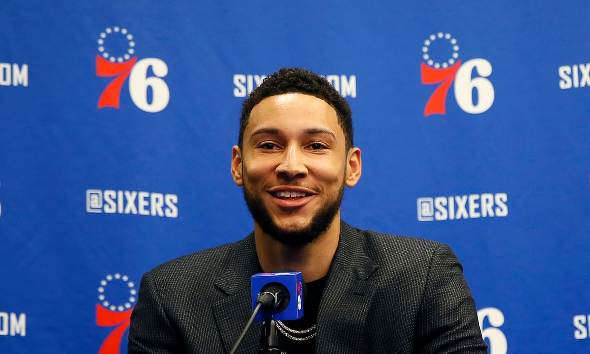 In this March 11, 2020, file photo, Philadelphia 76ers' Ben Simmons smiles while speaking at a news conference Philadelphia 76ers All-Star guard Ben Simmons is closer to getting cleared to play, should the NBA season resume. Simmons, the league leader in steals, was sidelined with nerve issues in his lower back when the season suspended was March 11 because of the coronavirus pandemic.