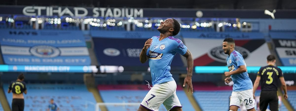Manchester City's Raheem Sterling celebrates after scoring the opening goal during the English Premier League soccer match between Manchester City and Arsenal at the Etihad Stadium in Manchester, England, Wednesday, June 17, 2020.