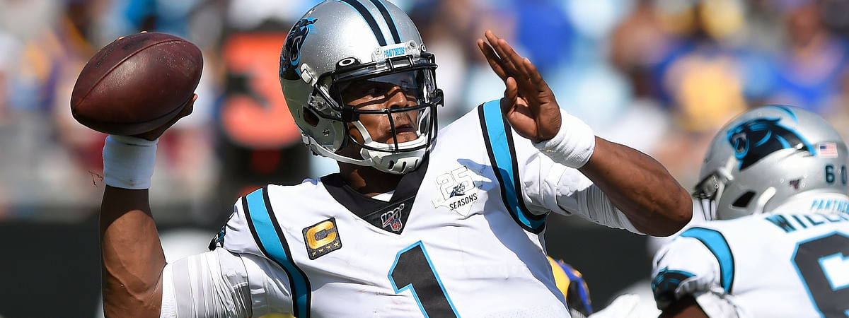 In this Sept. 9, 2019, file photo, Carolina Panthers quarterback Cam Newton looks for a receiver during the team's NFL football game against the Los Angeles Rams in Charlotte, N.C. The New England Patriots have reached an agreement with free-agent quarterback Newton, bringing in the 2015 NFL Most Valuable Player to help the team move on from three-time MVP Tom Brady, a person with knowledge of the deal told The Associated Press.