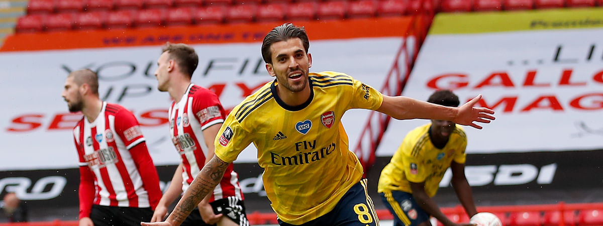 Arsenal's Dani Ceballos, front, celebrates after scoring his side's second goal during the FA Cup sixth round soccer match between Sheffield United and Arsenal at Bramall Lane in Sheffield, England, Sunday, June 28, 2020.