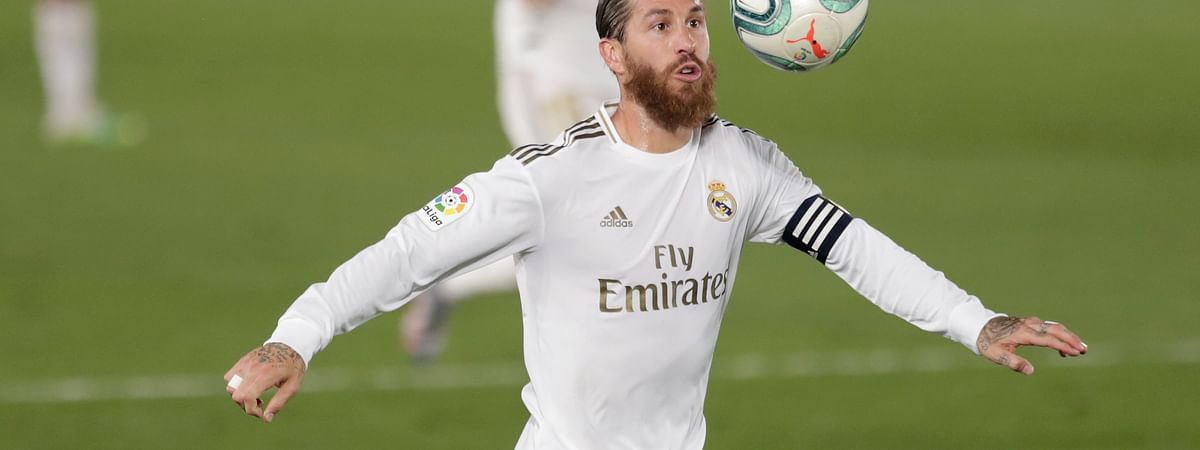 Real Madrid's Sergio Ramos eyes the ball during the Spanish La Liga soccer match between Real Madrid and Mallorca at Alfredo di Stefano stadium in Madrid, Spain, Wednesday, June 24, 2020.