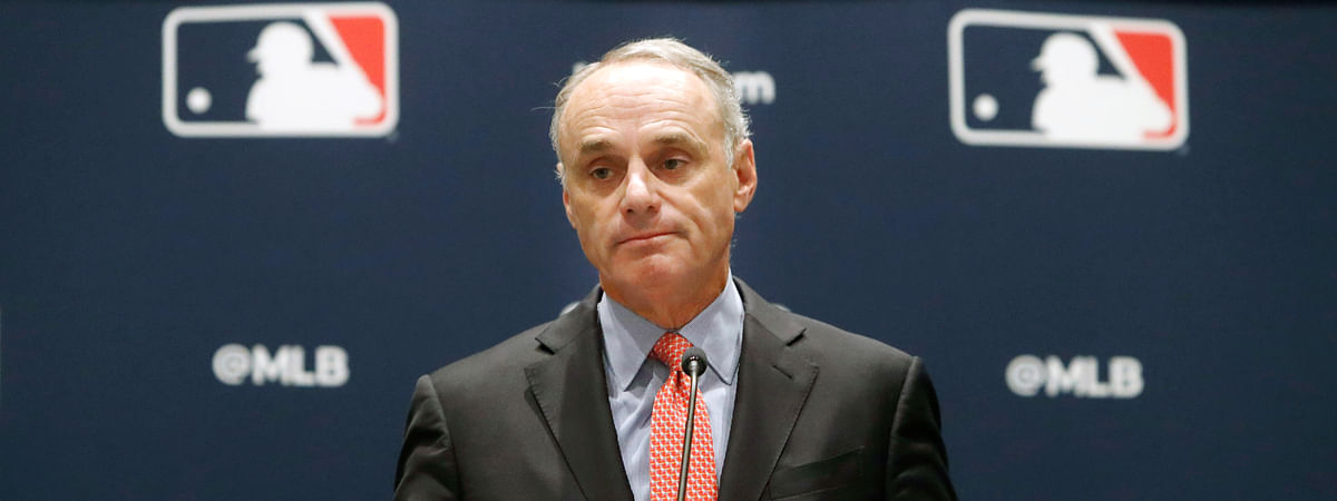 In this Nov. 21, 2019, file photo, baseball commissioner Rob Manfred speaks to the media at the owners meeting in Arlington, Texas. The chance that there will be no Major League Baseball season increased substantially Monday, June 15, 2020, when the commissioner's office told the players' association it will not proceed with a schedule unless the union waives its right to claim management violated a March agreement between the feuding sides.