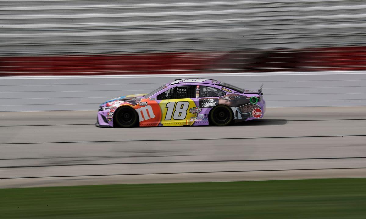 Kyle Busch (18) drives during a NASCAR Cup Series auto race at Atlanta Motor Speedway, Sunday, June 7, 2020, in Hampton, Ga.