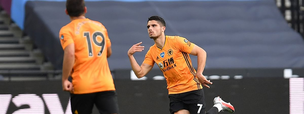 Wolverhampton Wanderers' Pedro Neto, center, celebrates after scoring his side's second goal during the English Premier League soccer match between West Ham and Wolverhampton at London stadium in London, England, Saturday, June 20, 2020.